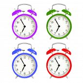 Alarm clocks isolated on white background. Red, blue green and purple wake up alarm clock cut outs.