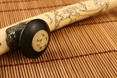 picture of opium  - An ivory opium pipe on a bamboo mat - JPG