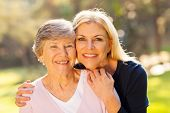 picture of grey-haired  - smiling senior woman and middle aged daughter outdoors closeup portrait - JPG
