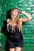 picture of sado-masochism  - beautiful young woman with a steel chain around his neck - JPG