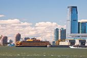 New York - The Massive Staten Island Ferry Departs From Battery Park In New York City