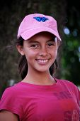 stock photo of pre-teen girl  - A portrait of a beautiful Hispanic pre-teen wearing pink and smiling.