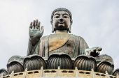 foto of cult  - Tian Tan Buddha also known as the Big Buddha is a large bronze statue of a Buddha - JPG