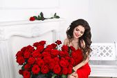 Beautiful Smiling Brunette Woman With Red Roses Bouquet, Valentines Day. Luxury Life.