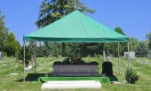 foto of mortuary  - Image of a steel Casket with Flowers on top in a cemetery - JPG