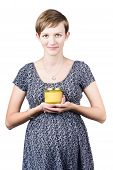 Holistic Naturopath Holding Jar Of Homemade Spread
