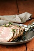 roasted pork neck with black pepper and herbs
