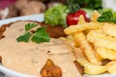 Schnitzel With Chips And Sauce