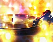 a close up of a record player with bokeh lights