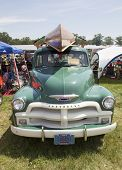 1954 Chevy 3100 Pickup With Wooden Canoe On Top Front View