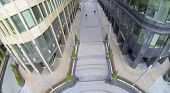Pavement between two office buildings. View from unmanned quadrocopter