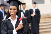 foto of graduation  - portrait of happy african female graduate at graduation - JPG