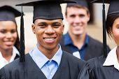 image of graduation gown  - portrait of young college graduates in graduation gown - JPG