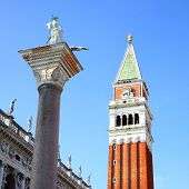 Campanile and statue of St.Theodore on San Marco square, Venice, Italy