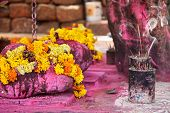 stock photo of pooja  - Saffron flower garlands and incense near Arambol temple Goa India