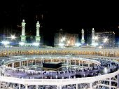 stock photo of mekah  - Kaaba the Holy mosque in Mecca with Muslim people pilgrims of Hajj praying in crowd  - JPG