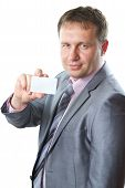 Close Up Portrait Of A Handsome Young Business Man In A Stylish Suit Holding Blank Business Card, Co