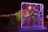 Perm, Russia - Jan 11, 2014: Illuminated Skeletonist Character Sculpture In Ice Town At Evening, Cre