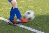 kicks a football