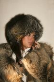 Girl in furs talking over the phone