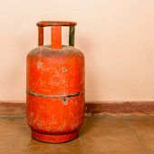 Red gas cylinder on pink cylinder