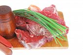 main course : fresh raw beef steak entrecote ready to prepare on cut board with green chives and tom