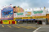 NEW YORK, SEPTEMBER 26, 2013 - Nathans hot dog contest countdown clock and Nathan's Famous restauran