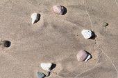 Stones In Wet Sand