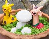 Happy Giraffe With Mushrooms Clay In  Pot