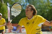 MOSCOW, RUSSIA - JULY 19, 2014: Vinicius Font of Brazil in the match against Spain during ITF Beach Tennis World Team Championship. Brazil won 2-1