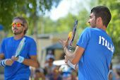 MOSCOW, RUSSIA - JULY 20, 2014: Marco Garavini (center) and Alessandro Calbucci of Italy in the final match against Brazil during ITF Beach Tennis World Team Championship. Italy won 2-0