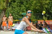 MOSCOW, RUSSIA - JULY 20, 2014: Ilona Giberte of Latvia in the match against Bulgaria during ITF Beach Tennis World Team Championship. Bulgaria won 3-0
