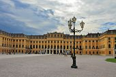 Hofburg - the winter residence of the Austrian Habsburg emperors. Palace and vintage lamps on a larg