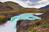 Gorgeous National Park in Chilean Patagonia. Affluent bustling Salto Grande waterfall with emerald w