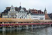 LUCERNE, SWITZERLAND - JULY 2, 2014: Chapel Bridge and Hotels on the Reuss River, Lucerne. The Chape