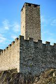BELLINZONA, SWITZERLAND - July 4, 2014: The Torre Bianca (White tower) of the Castelgrande in Bellinzona, Switzerland. A UNESCO World Heritage Site, seen from Piazza del Sole.