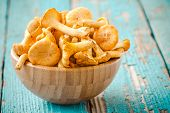 picture of chanterelle mushroom  - organic fresh chanterelle mushrooms on a wooden background - JPG