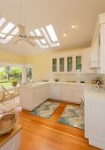 Classic kitchen in beautiful bright home with wood floors