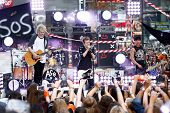 NEW YORK-JUL 22: (L-R) Michael Clifford, Luke Hemmings and Calum Hood of 5 Seconds Of Summer perform in concert on NBC's 'Today Show' at Rockefeller Plaza on July 22, 2014 in New York City.