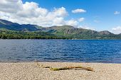 Beautiful sunny summer blue sky weather Coniston Water Lake District England uk mountains