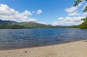 Coniston Lake District England uk mountains blue sky and white cloud on beautiful summer day