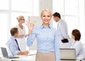 business and education concept - smiling businesswoman showing ok-sign with hand