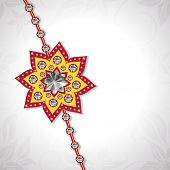 Beautiful floral design decorated rakhi on grey background for the occasion of Raksha Bandhan celebr