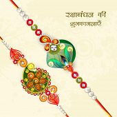 Beautiful peacock feather and pearls decorated rakhi with wishes for Raksha Bandhan celebrations on