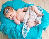 lovely newborn baby sleeps in a wicker basket
