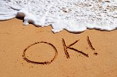 Ok written in sand
