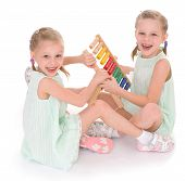 stock photo of montessori school  - Cute sisters work in the Montessori environment - JPG