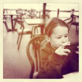 Child Playing there tablet - instagram effect