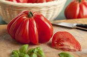 stock photo of boeuf  - Sliced fresh Coeur de Boeuf Tomato - JPG