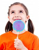 Portrait of little cute girl in orange t-shirt with colored candy - isolated on white.